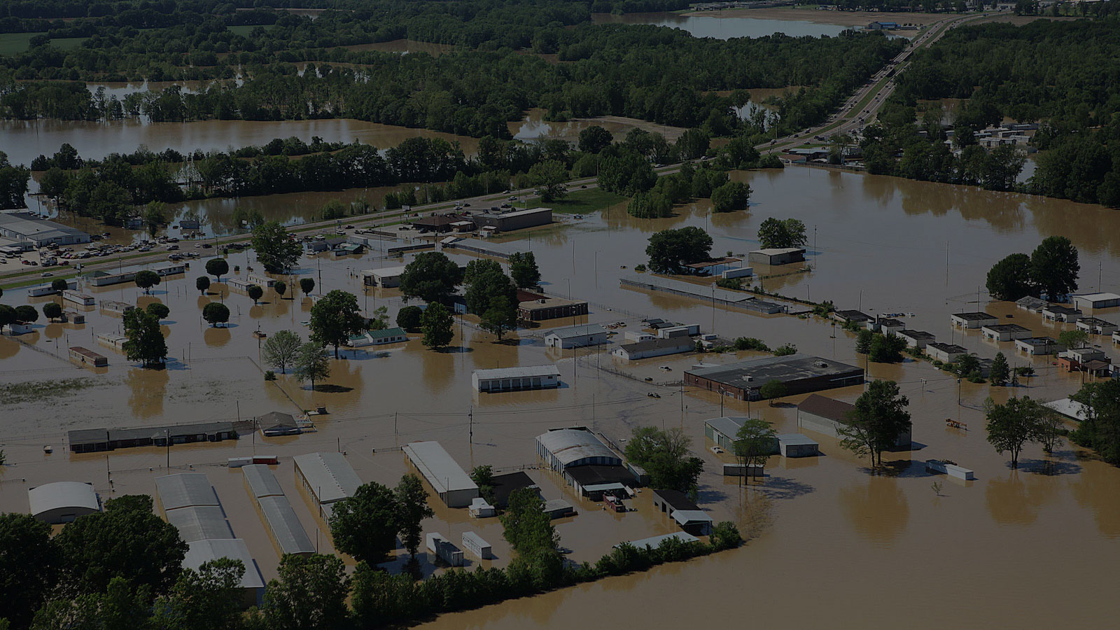 <h4>WE'RE ALREADY EXPERIENCING THE EFFECTS OF CLIMATE CHANGE</h4><h5>Stronger storms, sunny day flooding and sea level rise are threatening coastal communities. Droughts and worsening wildfire seasons threaten communities elsewhere. The result? Millions of Americans risk losing their homes.</h5><em>FEMA via Public Domain</em>
